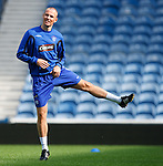Kenny Miller stretching at training