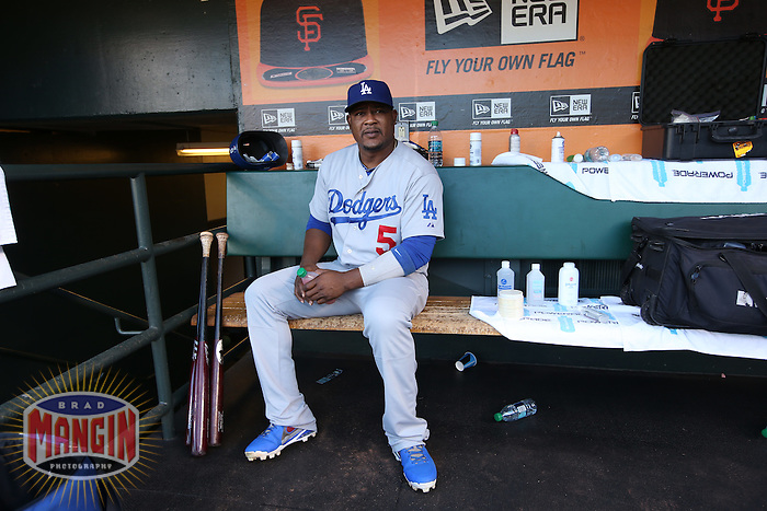 SAN FRANCISCO, CA - JULY 26:  Juan Uribe #5 of the Los Angeles Dodgers sits in the dugout before the game against the San Francisco Giants at AT&T Park on Saturday, July 26, 2014 in San Francisco, California. Photo by Brad Mangin