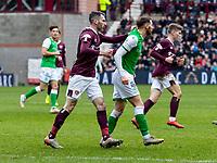 26th December 2019; Tynecastle Park, Edinburgh, Scotland; Scottish Premiership Football, Heart of Midlothian versus Hibernian FC; Michael Smith of Hearts argues Martin Boyle of Hibernian  - Editorial Use