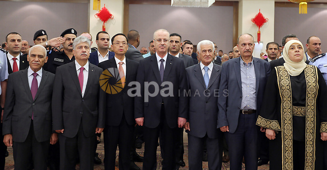Palestinian Prime Minister Rami Hamdallah take part during the ceremony of the sixty-eighth anniversary of the founding of the People's Republic of China, in the West Bank city of Ramallah on September 20, 2017. Photo by Prime Minister Office