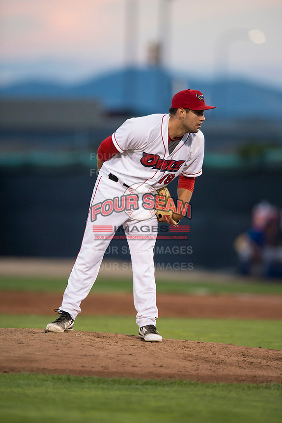 Orem Owlz relief pitcher Johnny Morell (18) looks in for the sign during a Pioneer League game against the Ogden Raptors at Home of the OWLZ on August 24, 2018 in Orem, Utah. The Ogden Raptors defeated the Orem Owlz by a score of 13-5. (Zachary Lucy/Four Seam Images)
