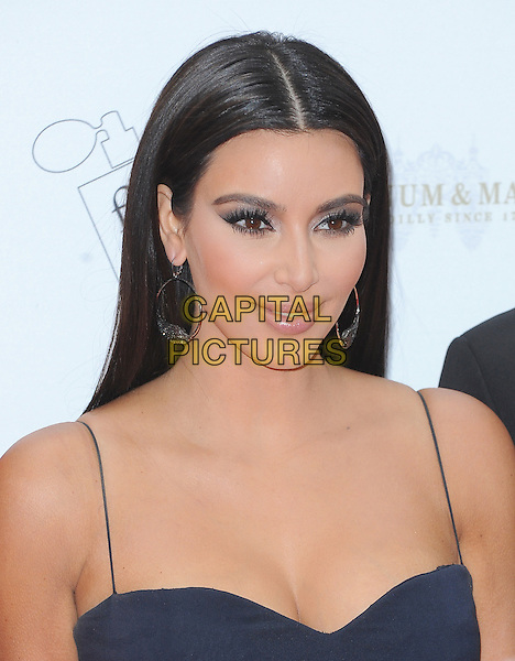 Kim Kardashian.The FiFi UK Fragrance Awards 2012 at The Brewery, Chiswell Street, London, England..May 17th 2012.headshot portrait blue black cleavage  hoop earrings .CAP/BEL.©Tom Belcher/Capital Pictures.