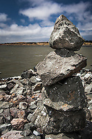 Rock Balancing - an art form or hobby.  Rocky creations rise along the rocky shores of the San Leandro Marina on San Francisco Bay.  Pereidolia, the mind making sense of what is seen (my paraphrase).  Do you see a face at the top of the stacked, balanced, rocks?   If so, that's pareidolia.