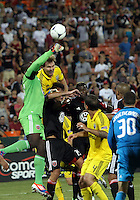 WASHINGTON, DC - AUGUST 4, 2012:  Bill Hamid (28) of DC United punches the ball away from Chad Marshall (14) of the Columbus Crew late in the game during an MLS match at RFK Stadium in Washington DC on August 4. United won 1-0.