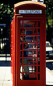 Buenos Aires, Argentina. Man speaking on the telephone in a British style telephone box.