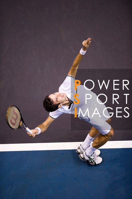 BANGKOK, THAILAND - OCTOBER 01:  Mikhail Kukushkin of Kazakhstan serves against Rafael Nadal of Spain during the Day 7 of the PTT Thailand Open at Impact Arena on October 1, 2010 in Bangkok, Thailand. Photo by Victor Fraile / The Power of Sport Images