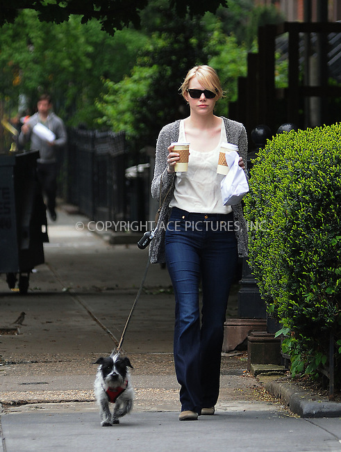 WWW.ACEPIXS.COM . . . . .  ....May 4 2012, New York City....Actress Emma Stone juggles walking her pup with picking up coffee in her Chelsea neighborhood on May 4 2012 in New York City....Please byline: CURTIS MEANS - ACE PICTURES.... *** ***..Ace Pictures, Inc:  ..Philip Vaughan (212) 243-8787 or (646) 769 0430..e-mail: info@acepixs.com..web: http://www.acepixs.com