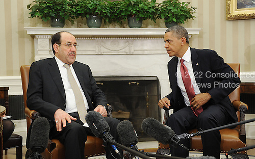 Prime Minister Nouri Al-Maliki of Iraq, left, speaks with United States President Barack Obama in the Oval Office at the White House November 1, 2013 in Washington, DC. <br /> Credit: Olivier Douliery / Pool via CNP