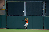 AZL Giants center fielder Ismael Munguia (29) catches a deep fly ball to record an out during the game against the AZL Reds on August 12, 2017 at Scottsdale Stadium in Scottsdale, Arizona. AZL Giants defeated the AZL Reds 1-0. (Zachary Lucy/Four Seam Images)