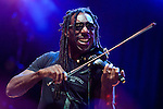 Boyd Tinsley perform with Michael Franti at the Life is Good Festival in Boston, Massachusetts on September 22, 2012