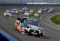 Feb 21, 2009; Fontana, CA, USA; NASCAR Camping World Truck Series driver Kyle Busch leads the field during the San Bernardino County 200 at Auto Club Speedway. Mandatory Credit: Mark J. Rebilas-