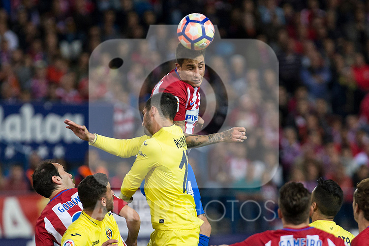 Jose Maria Gimenez of Atletico de Madrid battles for an aerial ball  Alvaro Gonzalez of Villarreal during the match of La Liga between Atletico de Madrid and Villarreal at Vicente Calderon  Stadium  in Madrid, Spain. April 25, 2017. (ALTERPHOTOS/Rodrigo Jimenez)
