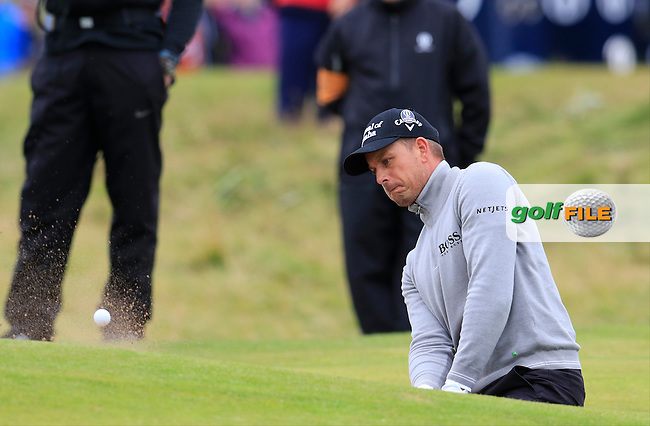 Henrik Stenson (SWE) chips from a bunker at the 3rd green during Saturday's Round 3 of the 145th Open Championship held at Royal Troon Golf Club, Troon, Ayreshire, Scotland. 16th July 2016.<br /> Picture: Eoin Clarke | Golffile<br /> <br /> <br /> All photos usage must carry mandatory copyright credit (&copy; Golffile | Eoin Clarke)