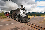 Cumbres & Toltec Scenic Railroad No. 484 (K-36) engine winds down the narrow-gauge tract westbound to Chama crossing the NM 17 highway grade