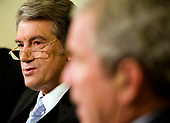 Washington, D.C. - September 29, 2008 -- Viktor Yushchenko, President of the Ukraine,  speaks with United States President George W. Bush during a meeting in the Oval Office of the White House in Washington, D.C., U.S., Monday, September 29, 2008. <br /> Credit: Joshua Roberts - Pool via CNP