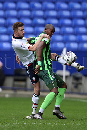 March 4th 2017,  Macron Stadium, Bolton, England;  Skybet league 1 football, Bolton Wanderers versus AFC Wimbledon;  Mark Beevers of Bolton Wanderers tangles with Tom Elliott of AFC Wimbledon