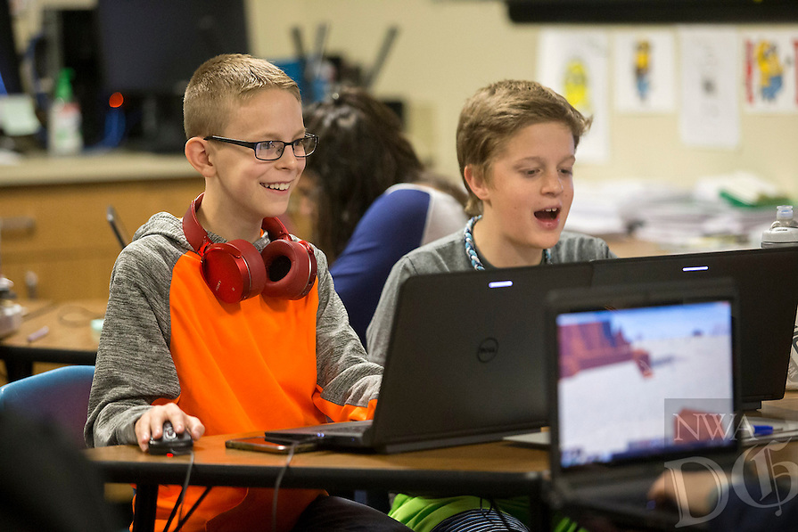 NWA Democrat-Gazette/JASON IVESTER<br /> Spencer Davis (left) and Luke Hoggatt (cq), both sixth-graders, use the Minecraft game to create a virtual living environment on Mars on Wednesday, Feb. 8, 2017, at Old High Middle School in Bentonville. Six schools across the region recently launched fundraising campaigns for their maker spaces, which promote education through hands-on work using various tools, 3-D printers, circuitry kits and other materials.