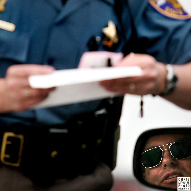 Colorado State Trooper Sarah Hargreaves issues a citation to Edward Smith for having a minor in his vehicle without a seat belt on I-25 in Fort Collins on Thursday, July 3, 2008. Fort Collins-area authorities will be cracking down over the Fourth of July weekend.  (Christopher McGuire)