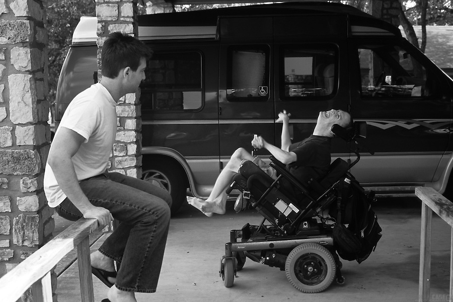 Sean Pevsner and his assistant, Michael Galante, hang out in front of Sean's house, and next to his custom van.<br /> <br /> Sean Pevsner was born with severe cerebral palsy. He is in his final year of law school at the University of Texas.