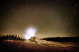 USA, Wyoming, Yellowstone National Park, geysers steam at Old Faithful Geyser Park at night
