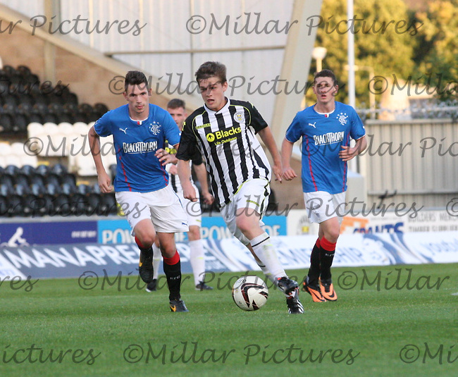 Lewis McLear being pursued by Kyle McAusland (left) in the St Mirren v Rangers Scottish Professional Football League Under 20 match played at St Mirren Park, Paisley on 10.9.13.