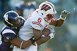 November 21, 2009: Northwestern Wildcats defensive back Jordan Mabin (26) tackles Wisconsin Badgers wide receiver Isaac Anderson (6) during an NCAA football game at  Ryan Field on November 21, 2009 in Evanston, Illinois. The Wildcats won 33-31. (Photo by David Stluka)