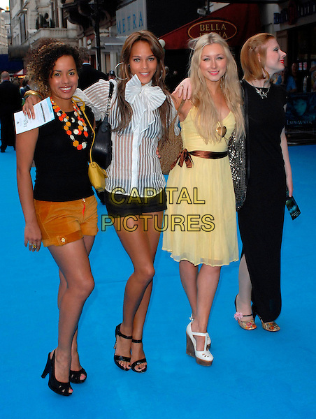 "HELENA DOWLING, LAUREN BLAKE, HAYLEY WARDLE & BRYONY AFFERSON - TOTALLY FRANK.""Lady In The Water"" - UK film Premiere, Vue West End, London, UK..August 8th, 2006.Ref: CAN.full length black shorts dress yellow.www.capitalpictures.com.sales@capitalpictures.com.©Can Nguyen/Capital Pictures"