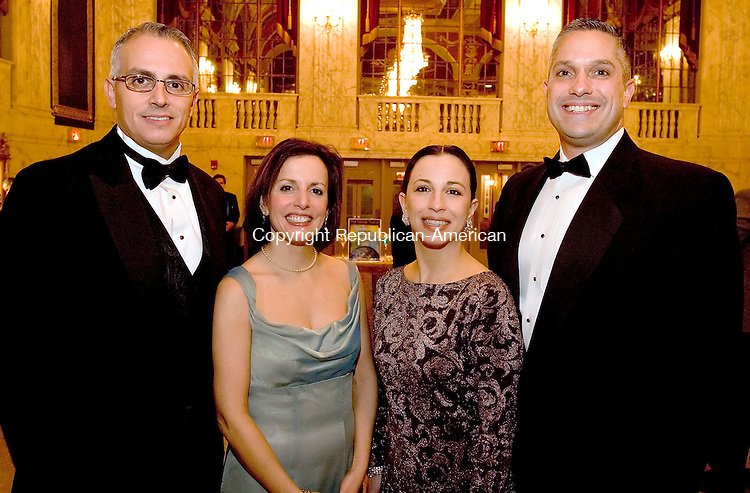WATERBURY, CT -31 DECEMBER 2005 -123105J15---Frank Tavera, left, Executive Director at the Palace Theater, and his wife Diedre, with Natalie and John Lawlor of Waterbury  second annual pre-season gala prior to the Earth, Wind and Fire concert on Friday evening.-- Jim Shannon Republican-American --  Diedre Tavera, Frank Tavera; Natalie Lawlor and John Lawlor, Earth; Wind and Fire; Palace Theater are CQ