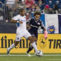 San Jose Earthquakes defender Justin Morrow (15) passes as New England Revolution defender Kevin Alston (30) pressures. In a Major League Soccer (MLS) match, the San Jose Earthquakes defeated the New England Revolution, 2-1, at Gillette Stadium on October 8, 2011.