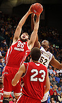 SIOUX FALLS, SD - MARCH 9:  Trevor Gruis #50 from the University of South Dakota battles for a rebound with Michael Ochereobia #52 from Western Illinois in the first half of their quarterfinal game Saturday evening at the 2013 Summit League Basketball Tournament in Sioux Falls, SD.  (Photo by Dave Eggen/Inertia)