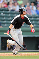 Third baseman Joey Gallo (30) of the Hickory Crawdads breaks his bat in a game against the Greenville Drive on Sunday, June 9, 2013, at Fluor Field at the West End in Greenville, South Carolina. Gallo is the No. 10 prospect of the Texas Rangers, according to Baseball America and was a first-round pick (39th overall) in the 2012 First-Year Player Draft. Hickory won, 6-3. (Tom Priddy/Four Seam Images)