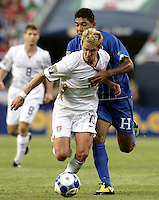 Stuart Holden (10) is pressured by Melvin Valladares (18).  The US Men's National Team defeated Honduras 2-0 in the semifinals of the Gold Cup at Soldier Field in Chicago, IL on July 23, 2009.