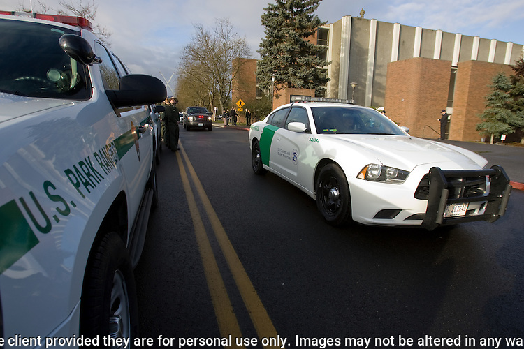 Law Enforcement vehicles drive in the procession during memorial services for National Park Service Ranger Margaret Anderson at the Pacific Lutheran University in Tacoma on January 10, 2010.  Anderson, was slain at Mount Rainier on New Years' Day when she set up a road block to intercept a vehicle, driven by Benjamin Barnes, who failed to stop at a chain-up checkpoint.  Barnes, the suspect  in the shooting was found dead was found dead the next day. He had drown in Paradise Creek. ©2012. Jim Bryant Photo. All RIGHTS RESERVED.