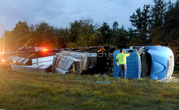 STATEN ISLAND, NY - AUGUST 21: An overturned trailer carrying metal framing studs stops traffic at the Westshore Expressway in Staten Island, causing major delays in the morning traffic on August 21, 2015. The driver was unhurt and walked away from the accident. Credit: Dennis Van Tine/MediaPunch
