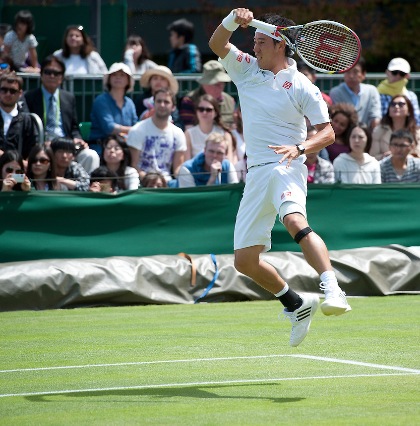 Kei Nishikori (JPN) [12] in action during his defeat by Andreas Seppi (ITA) [23] in their Gentlemen's Singles Third Round match today - Andreas Seppi (ITA) [23] def Kei Nishikori (JPN) [12] 3-6 6-2 6-7(4) 6-1 6-4 <br /> <br />  (Photo by Stephen White/CameraSport) <br /> <br /> Tennis - Wimbledon Lawn Tennis Championships - Day 6 Saturday 29th June 2013 -  All England Lawn Tennis and Croquet Club - Wimbledon - London - England<br /> <br /> &copy; CameraSport - 43 Linden Ave. Countesthorpe. Leicester. England. LE8 5PG - Tel: +44 (0) 116 277 4147 - admin@camerasport.com - www.camerasport.com.