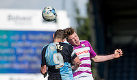 Harry Taylor of Barnet beats Paul Hayes of Wycombe Wanderers in the air during the Sky Bet League 2 match between Wycombe Wanderers and Barnet at Adams Park, High Wycombe, England on 16 April 2016. Photo by Andy Rowland.