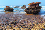 Rocks in the sea at Legzira Beach, Atlantic Ocean, Morocco.