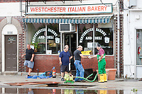MAMARONECK, NY - AUGUST 28: Mayor Norman Rosenblum of the Village of Mamaroneck, New York shakes hands with a resident pumping water out of the basement of a small business on Sunday August 28, 2011 in the aftermath of Hurricane Irene.