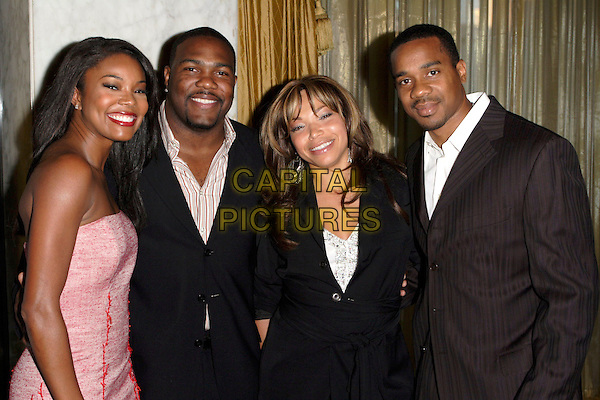 GABRIELLE UNION & TISHA CAMPBELL MARTIN WITH HUSBANDS.The 9th Annual Family Matters Benefit and Celebration held at the Regent Beverly Wilshire Hotel, Beverly Hills, Los Angeles, California, USA, 3 June 2005..half length married wife.Ref: ADM.www.capitalpictures.com.sales@capitalpictures.com.©AdMedia/Capital Pictures.
