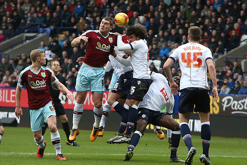 27.02.2016. Macron Stadium, Bolton, England. Skybet Championship. Bolton versus Burnley. Sam Vokes of Burnley and Derik Osede of Bolton Wanderers collide challenging for a header