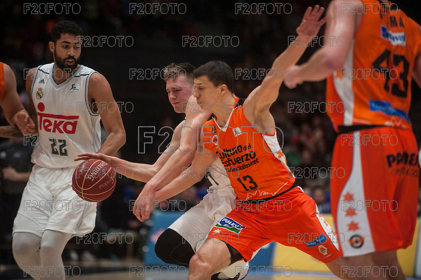 VALENCIA, SPAIN - FEBRUARY 28: Luka Doncic, Vladimir Lucic, John Shurna, Augusto Lima during ENDESA LEAGUE match between Valencia Basket Club and Real Madrid at Fonteta Stadium on   February, 2016 in Valencia, Spain