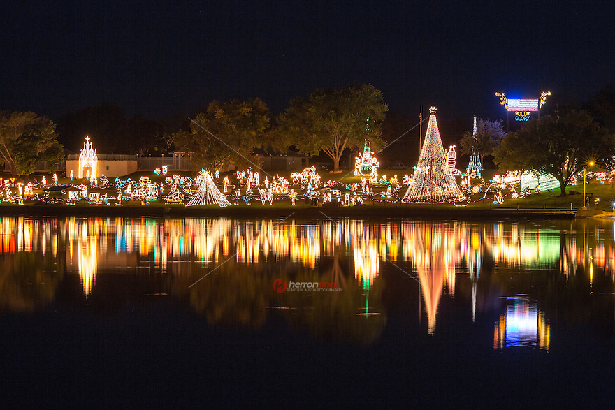 Featuring over two million lights, the Walkway of Lights located in Marble Falls, Texas, is a season-long Christmas extravaganza. Walk the lighted pathway along beautiful Lake Marble Falls featuring Christmas-themed, whimsical and patriotic light features and sculptures - Stock Image.