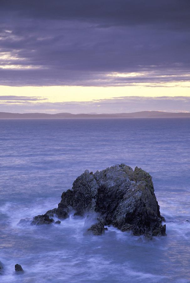 Urchin Rocks below storm clouds, Rosario Head, Deception Pass State Park, Washington