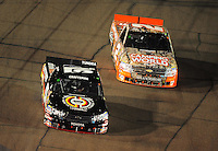 Nov. 7, 2008; Avondale, AZ, USA; Nascar Craftsman Truck Series driver Kyle Busch (51) races alongside Kevin Harvick (2) during the Lucas Oil 150 at Phoenix International Raceway. Mandatory Credit: Mark J. Rebilas-
