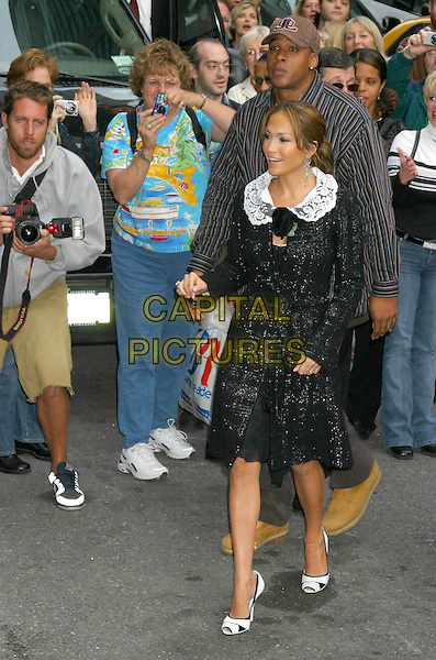 JENNIFER LOPEZ.Arrives for the David Letterman Show in New York City, USA, October 13th 2004..full length black tweed jacket coat black rose flower corsage white lace collar stilettoes shoes .Ref: IW.www.capitalpictures.com.sales@capitalpictures.com.©Capital Pictures.