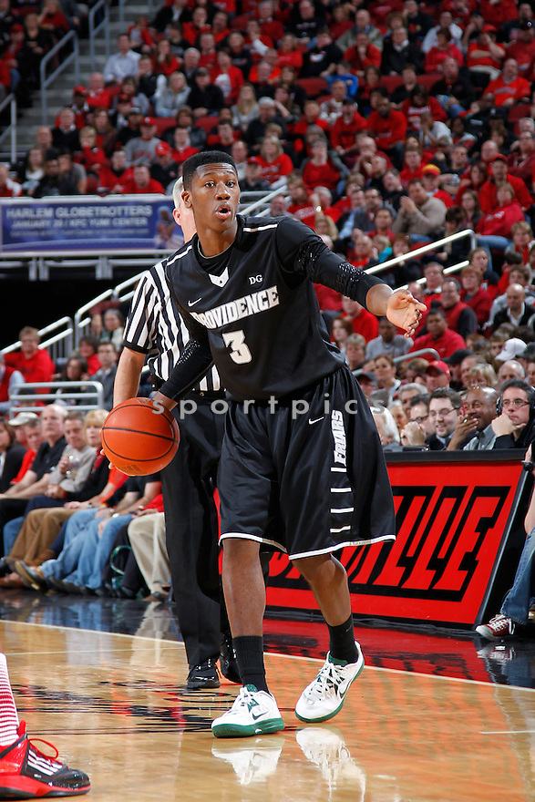 LOUISVILLE, KY - JANUARY 2: Kris Dunn #3 of the Providence Friars handles the ball against the Louisville Cardinals during the game at KFC Yum! Center on January 2, 2013 in Louisville, Kentucky. Louisville won 80-62. Kris Dunn