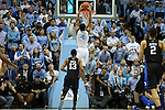 17 February 2016: North Carolina's Isaiah Hicks (4) gets behind Duke's Matt Jones (13) and dunks the ball. The University of North Carolina Tar Heels hosted the Duke University Blue Devils at the Dean E. Smith Center in Chapel Hill, North Carolina in a 2015-16 NCAA Division I Men's Basketball game. Duke won the game 74-73.