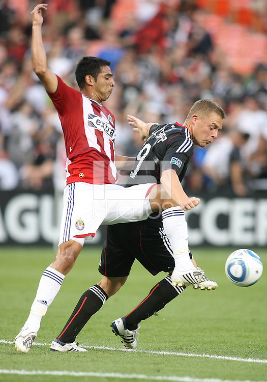 Danny Allsopp #9 of D.C. United is tackled by Michael Umana #4 of Chivas USA during an MLS match at RFK Stadium, on May 29 2010 in Washington DC. United won 3-2.