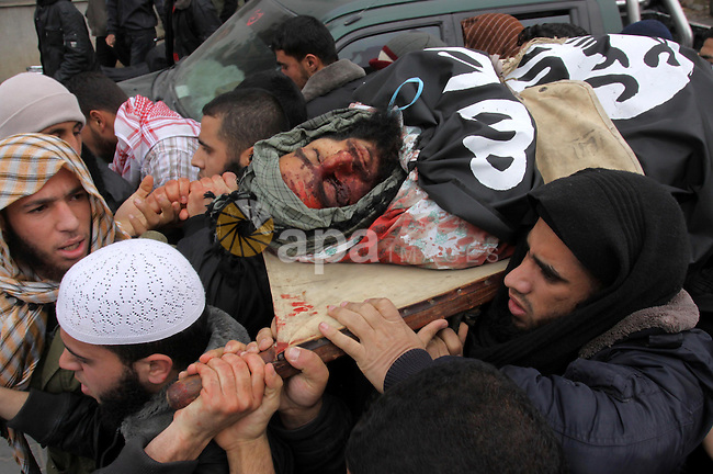 Palestinians carry the body of militant Momen Abu Daf during his funeral in Gaza City December 30, 2011. Israel killed the leader of an al Qaeda-inspired faction in the Gaza Strip on Friday, accusing him of involvement in firing rockets and a planned attack on the Jewish state from the neighbouring Egyptian Sinai. Photo by Mohammed Asad