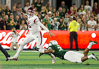 NWA Democrat-Gazette/BEN GOFF @NWABENGOFF<br /> Cole Kelley, Arkansas quarterback, tries to fend off Emmanuel Jones, Colorado State defender, late in the 4th quarter Saturday, Sept. 8, 2018, at Canvas Stadium in Fort Collins, Colo.